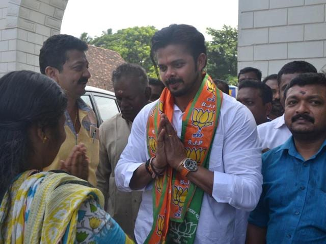 BJP candidate from Thiruvananthapuram S Sreesanth greets residents during a poll campaign.