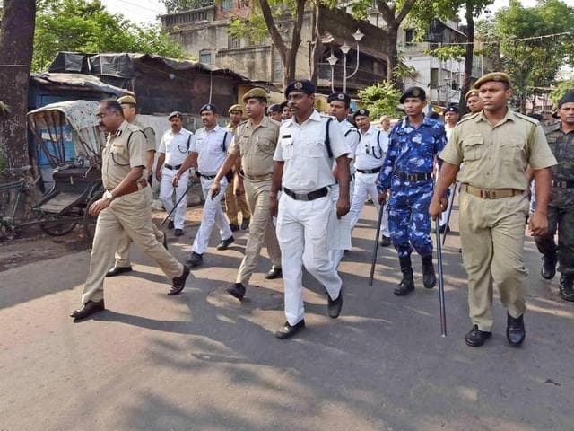 Security personnel patrol during the 5th phase of West Bengal Assembly elections in Kolkata on Saturday.