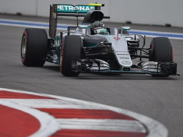Mercedes driver Nico Rosberg, of Germany, celebrates after setting the pole position during the qualifying session for Sunday's Formula One Russian Grand Prix at the Sochi Autodrom in Sochi, Russia, on April 30, 2016.