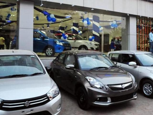 Chandigarh, India, November 09 :: The buyers Looking New cars at One of the Showroom In Industrial Area Phase 1 Chandigarh on Monday, November 09, 2015