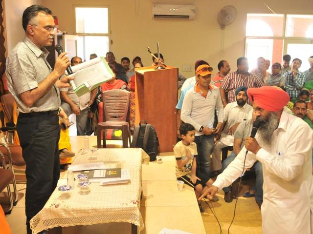 Management of Shiv Jyoti Public School trying to pacifying the members of parents association during a meeting in Jalandhar on Saturday.