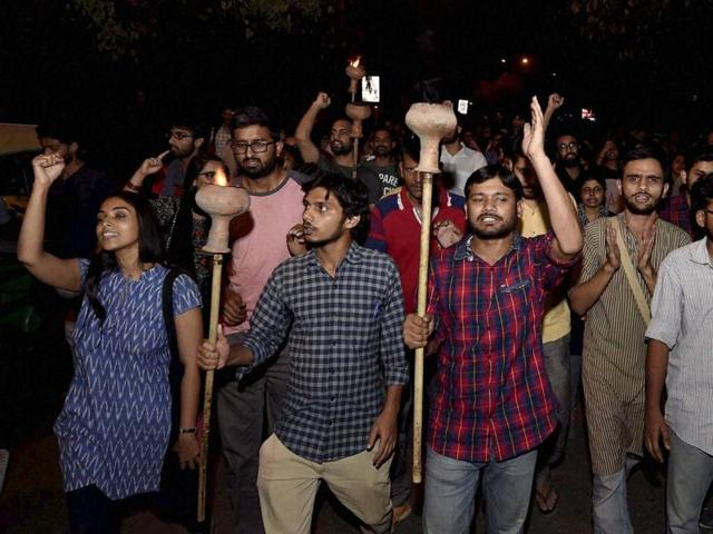 Kanhaiya Kumar with Umar Khalid and other students carried torch parade at JNU campus in New Delhi on Wednesday.