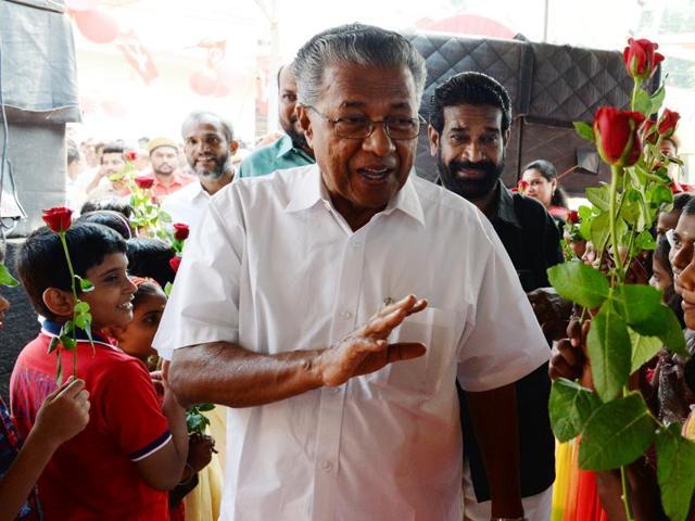 CPM leader Pinarayi Vijayan being welcomed at Kalamassery in Kochi.