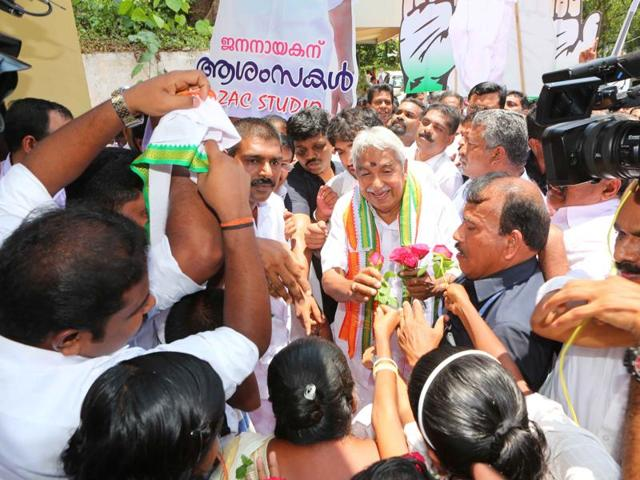 Kerala chief minister Oommen Chandy talking to newsmen after submitting his papers from Puthuppally in Kottayam district.