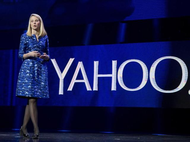 File photo of  Yahoo president and CEO Marissa Mayer . Mayer will walk away with a $55 million severance package if the company's auction of its Internet operations culminates in a sale that ousts her from her job.