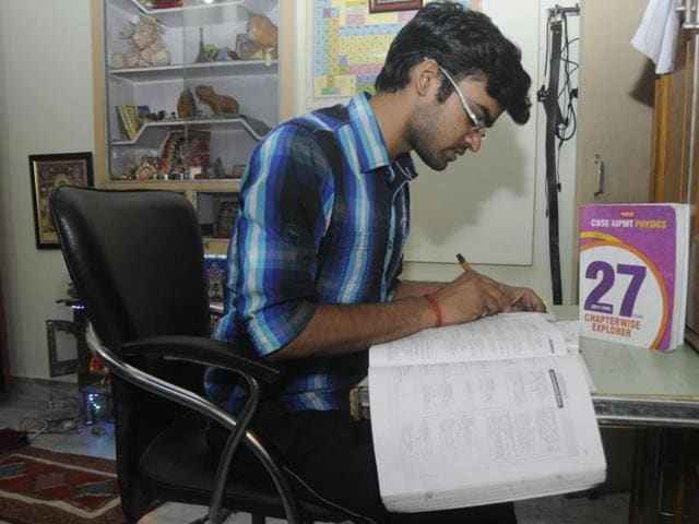 Aspirant  Utkarsh Agarwal preparing for NEET 1 at his residence in Lucknow on Saturday.