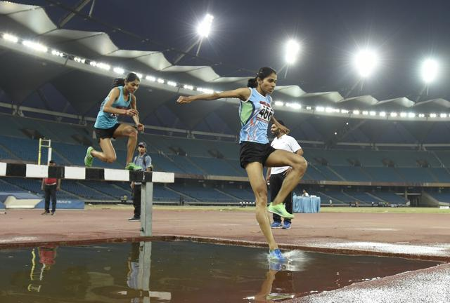Lalita Babar (left) and Sudha Singh cempete in 3000m steeplechase during the Federation Cup at the Jawaharlal Nehru Stadium in New Delhi on Friday.