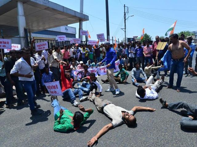 Labourers working on the site of Gammon India protest against non-payment of wages, in Bhopal on Sunday.