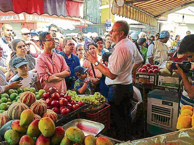 Lokesh Ohri (R) addresses heritage enthusiasts during the food heritage walk in Dehradun on Sunday.