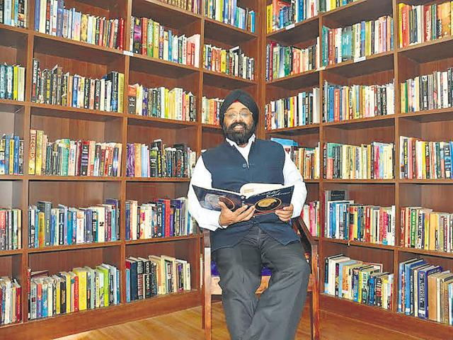 Paramjeet Singh in his massive library.