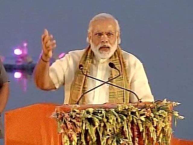 Prime Minister Narendra Modi addresses a gathering at Assi Ghat in Varanasi