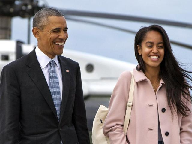President Barack Obama jokes with his daughter Malia Obama as they walk to board Air Force One. Like her parents, Malia will be joining Harvard University in 2017, after taking a year off before that.
