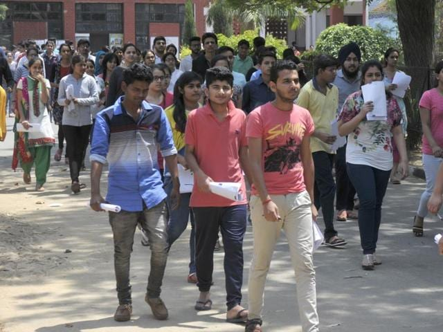 Candidates coming out after the AIPMT entrance exam in Chandigarh on Sunday.