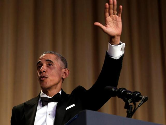 President Barack Obama laughs as he listens to Larry Wilmore, the guest host from Comedy Central, speak at the annual White House Correspondents' Association dinner on Saturday.