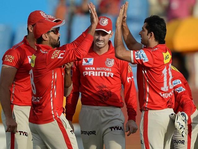 Kings XI Punjab Mohit Sharma celebrates with teammates.