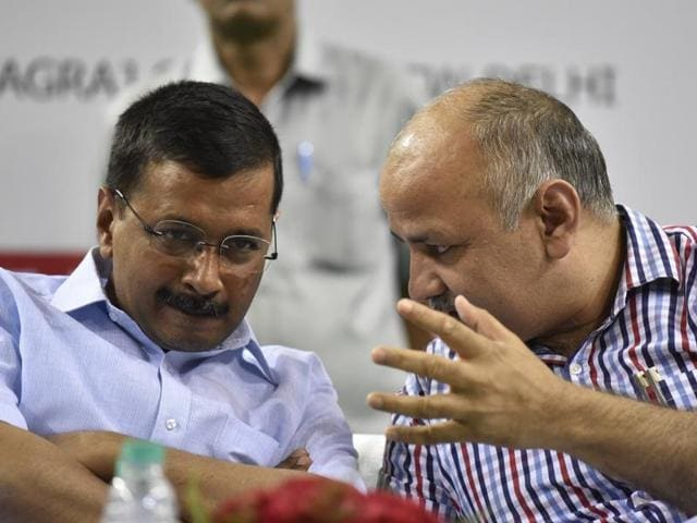 Delhi chief minister Arvind Kejriwal interacts with Dy CM Manish Sisodia during the launch of a mobile application for estate managers of government schools. Kejriwal said on Saturday a draft bill for full statehood of the Capital is ready.