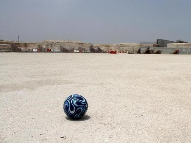 A football is seen at the construction site of Al Wakrah stadium, that is expected to host football matches during the 2022 World Cup.