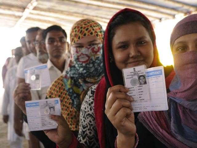 People queue up to vote during the 5th phase of Assembly Election at Topshia in South Kolkata. (Photo by Subhendu Ghosh/ Hindustan Times)