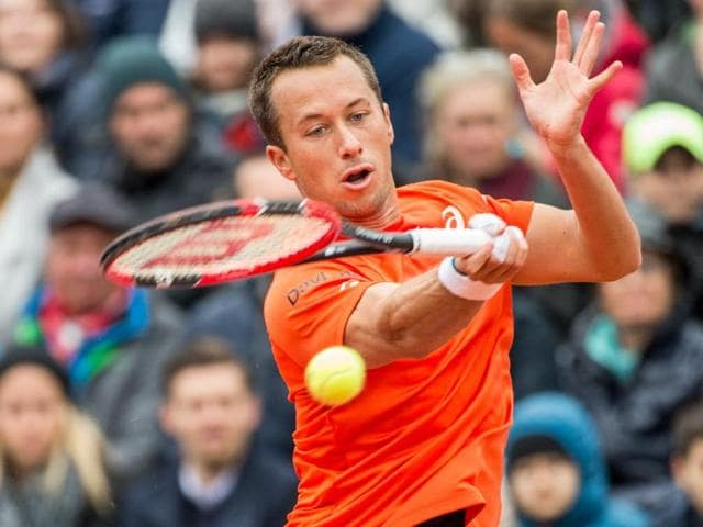 Germany's Philipp Kohlschreiber returns the ball to Austria's Dominic Thiem during the final of the ATP Munich Open on May 1, 2016.