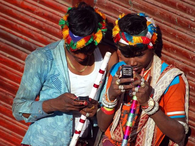 Most of the tribal youths now know how to use WhatsApp and many carry mobile phones with them.