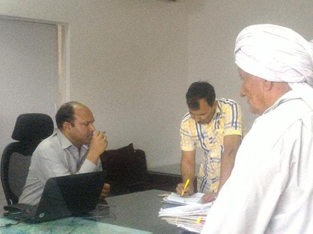 Kaithal deputy commissioner Ravi Prakash Gupta, who is visually impaired, attending to citizens on Saturday.