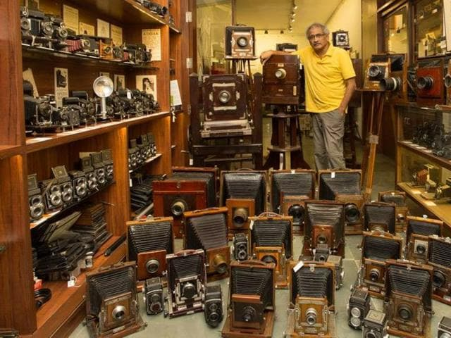 Aditya Arya with his rare cameras that were manufactured between 1889 and 1990.