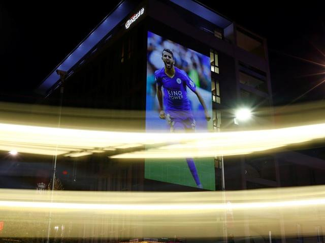 An image of Leicester City's Riyad Mahrez is projected on to a hotel during the