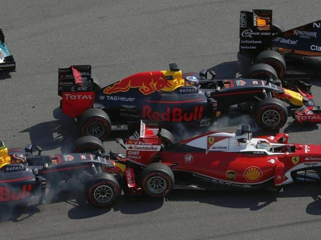 Ferrari driver Sebastian Vettel of Germany, right, is pushed by Russia's Red Bull driver Daniil Kvyat, left, while Australian Red Bull driver Daniel Ricciardo and Force India driver Sergio Perez of Mexico, rear right, pass by during the Russian Grand Prix.