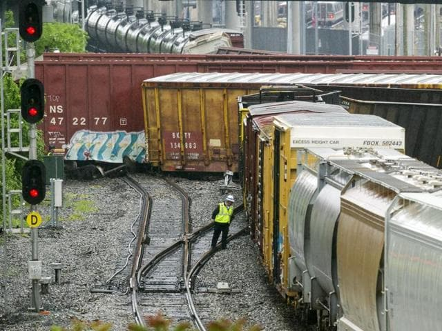 An emergency services employee works at the scene of train derailment in Washington.