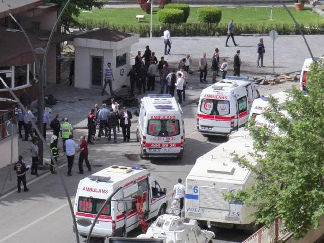 Ambulances are parked outside the police headquarters in the southeastern Turkish city of Gaziantep on May 1, 2016 after a bomb exploded, killing one police officer.