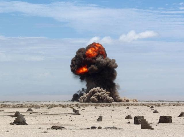 Smoke and fire billow from the desert of al Alam, east of the southern port city of Aden during a controlled explosion by Yemeni security forces to destroy explosives and mines laid by the al Qaeda.