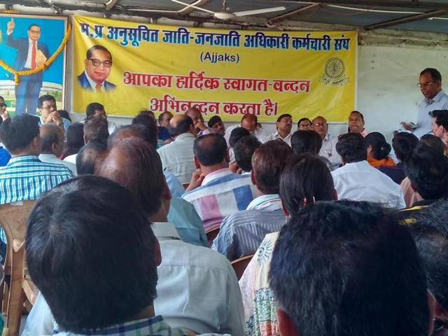 Government employees associated with AJJAKS hold a meeting in Bhopal to discuss high court`s order on reservation in promotions.