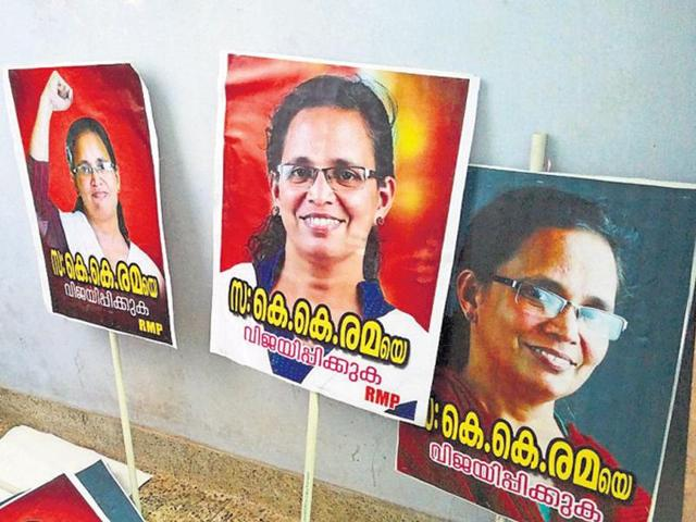 Placards for Rema's campaigns at her office. She says this election is a chance for people to react to her husband's murder.