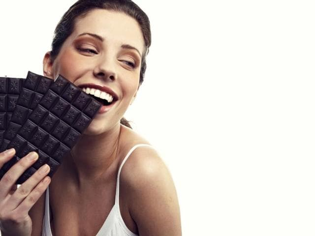 Dark chocolate provides similar benefits to beetroot juice, taken regularly by elite athletes after studies showed it can improve performance.(Shutterstock)