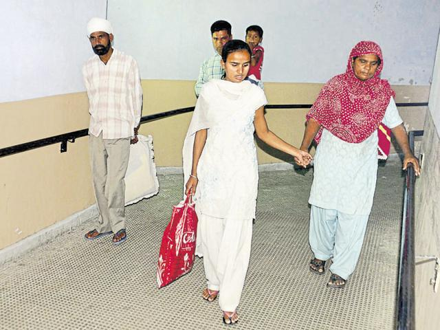 Patients forced to take the ramp in absence of functional elevators in the old building of the hospital in Amritsar.