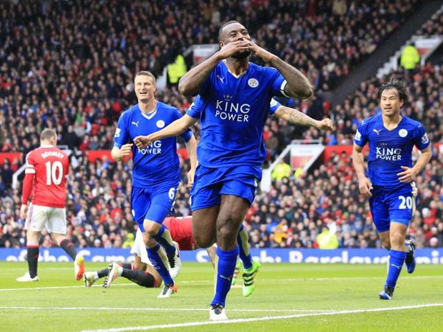 Leicester's Wes Morgan, centre, celebrates after scoring during the English Premier League match against Manchester United.