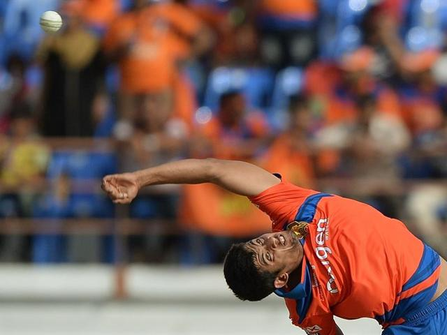 Gujarat Lions bowler Shivil Kaushik bowls during the IPL match against Kings XI Punjab.