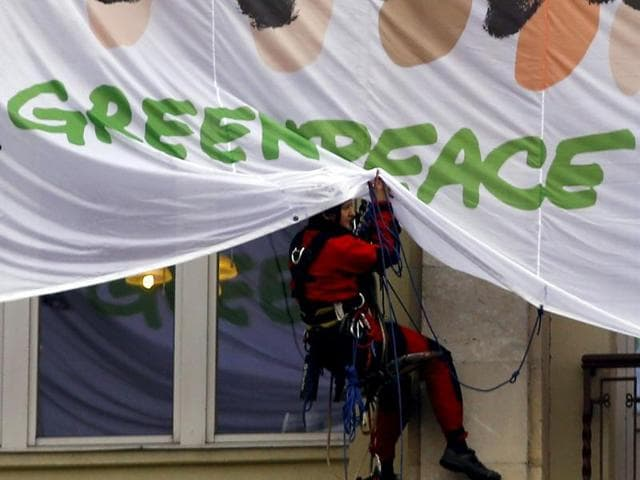 Greenpeace activists block the main entrance of a conference centre where negotiators are expected to discuss the 12th Round of the Transatlantic Trade and Investment Partnership (TTIP) in Brussels, Belgium.