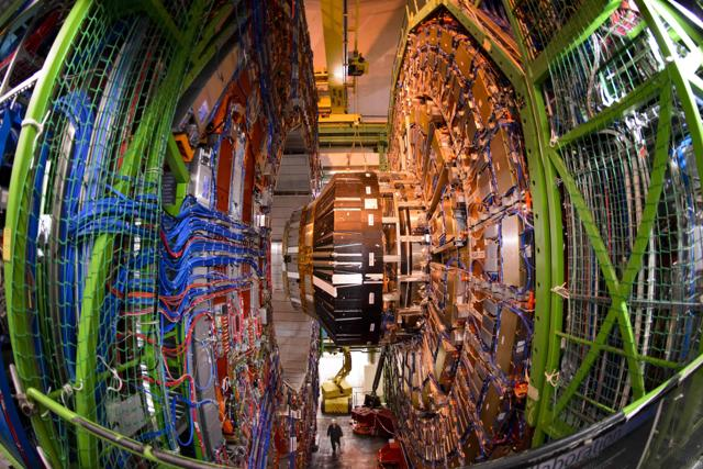 A worker standing below the Compact Muon Solenoid (CMS), a general-purpose detector at the European Organisation for Nuclear Research (CERN) Large Hadron Collider (LHC), during maintenance works in Meyrin, near Geneva.