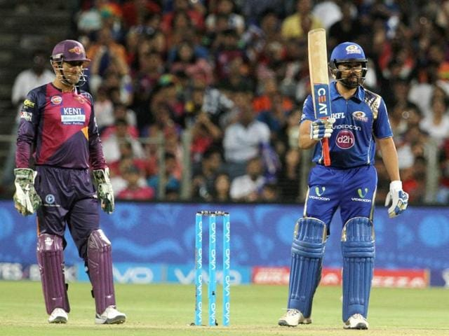 Mumbai Indians captain Rohit Sharma raises his bat after scoring a fifty during the IPL T20 match between the Rising Pune Supergiants and the Mumbai Indians at the  MCAstadium in Pune.