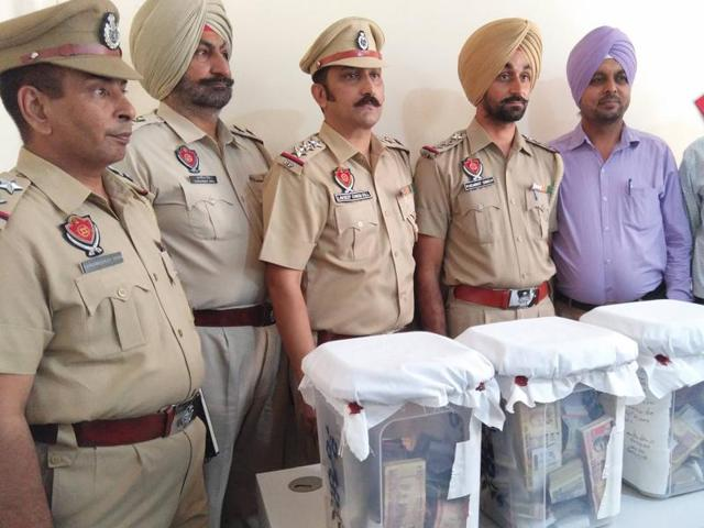 Police showcasing the ransom money recovered from the accused in Ludhiana on Monday.