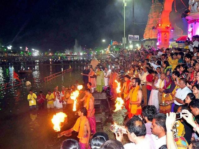 Devotees attend a aarti of holy river Kshipra during month long Simhastha Maha Kumbh Mela in Ujjain.