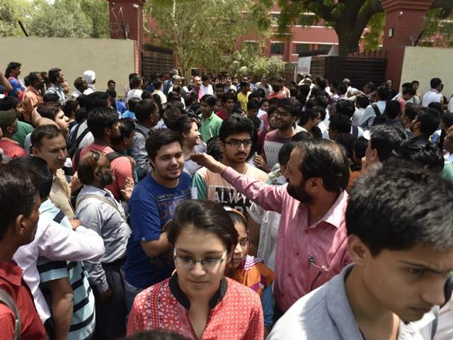 Students coming out after taking the NEET exam at the examination center at Kerala School in New Delhi.