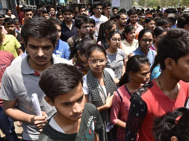 Students coming out after appearing for NEET phase 1 at DPS RK Puram in New Delhi on Sunday.