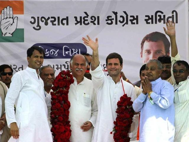 Congress party vice-president Rahul Gandhi (center), greets supporters during an election rally at Balasinor, Gujarat. (AP Photo)