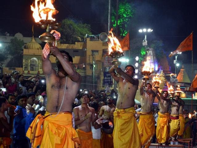 Priests offer evening aarti at Ram Ghat in Ujjain on Monday.