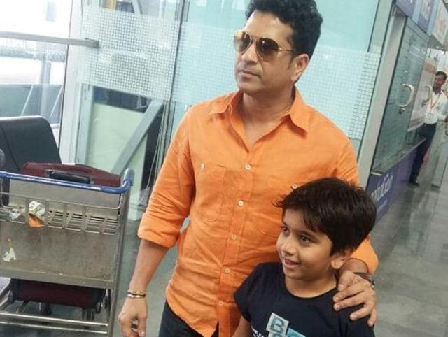 Sachin Tendulkar obliges his fan by accepting a request for a photo at Dehradun airport on Monday.