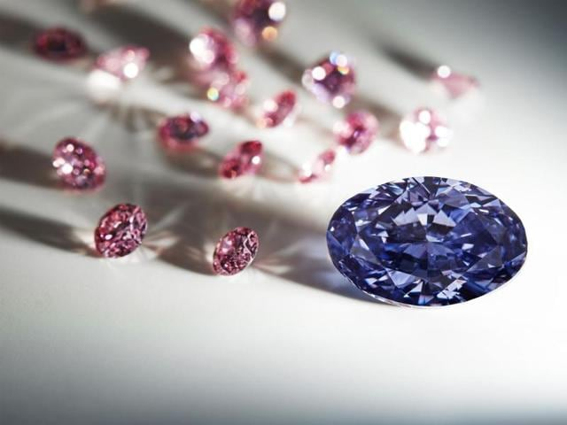 This undated handout picture released by Rio Tinto shows a rare violet uncut diammond discovered at Australia's remote Argyle mine.