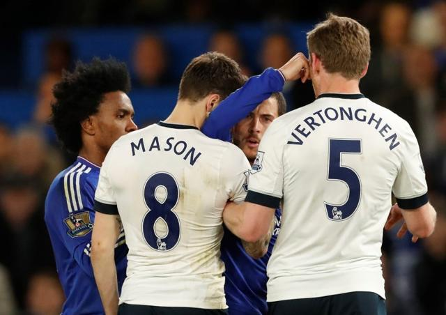 Chelsea's Diego Costa clashes with Tottenham's Mousa Dembele after the match.