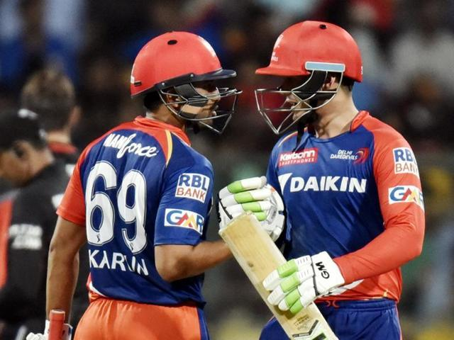 Delhi Daredevils' Quinton De Kock and Karun Nair in action against Royal Challengers Bangalore during their IPL match in Bangalore on April 17, 2016.